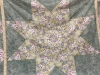 Pat Clark-two Lonestar quilts. One had a green background, and one was all pale shades of teal, mauve, and pink