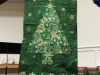 Pat Clark-a green, lighted Christmas tree as a gift for Peg Barnes