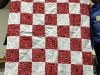 Peg Barnes-a red and white alternating block quilt, as a Community Service donation